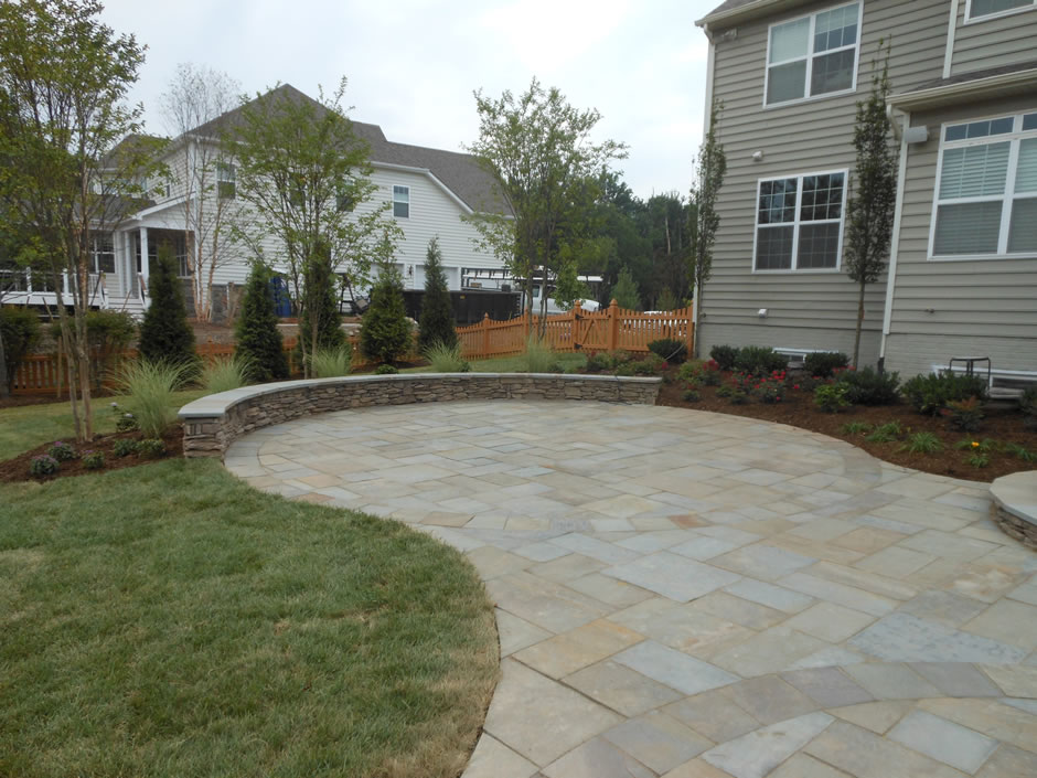 Flagstone patio seating wall masonry Ashburn