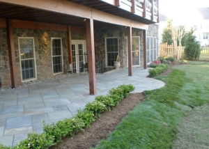 Flagstone patio under deck Ashburn