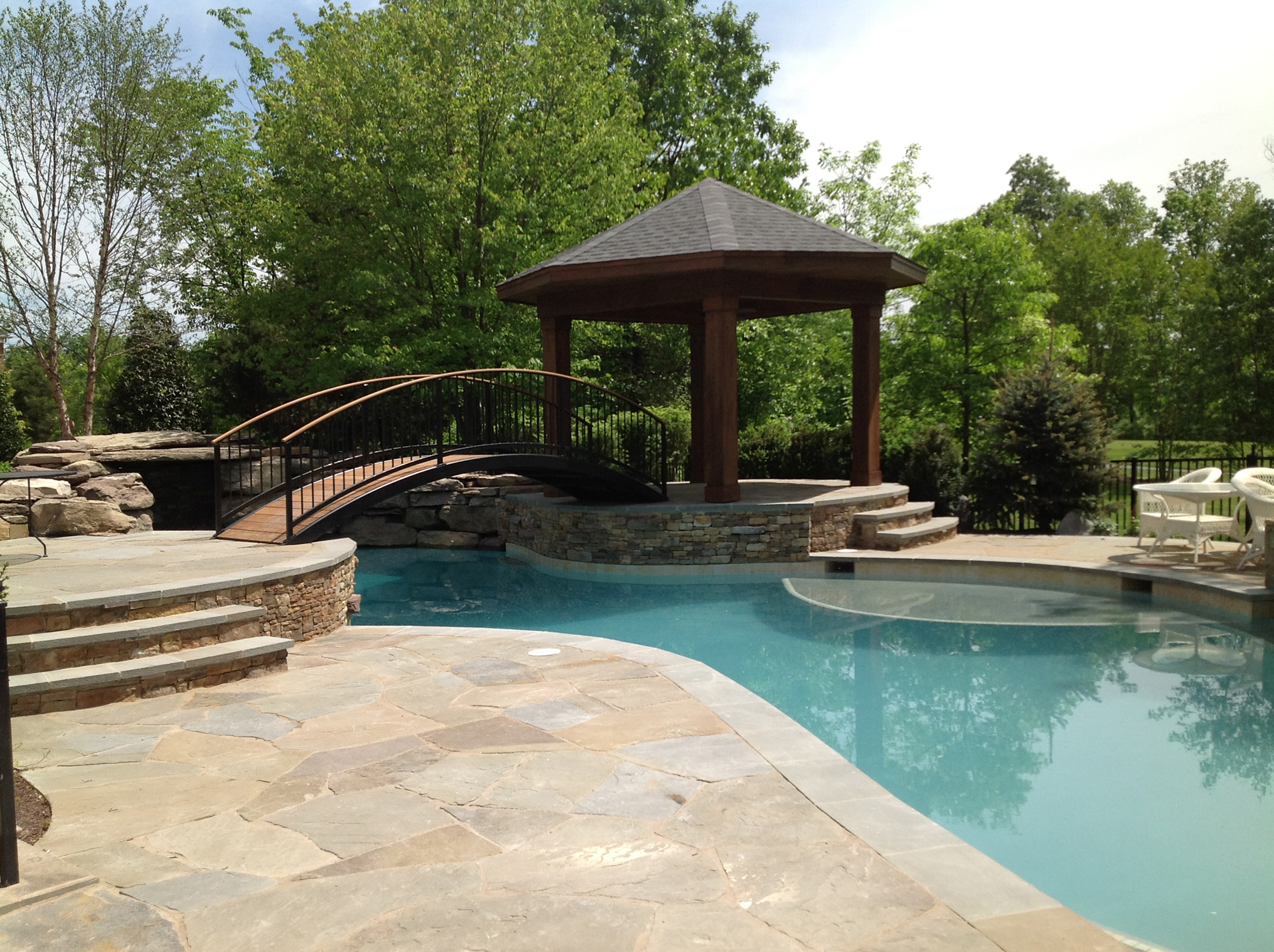 Gazebo Bridge And Lagoon Style Pool In Ashburn, VA